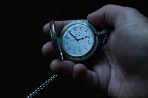 Person holding a watch